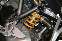 Shock Absorber. Yellow shock absorber on a modern bike Stock Photos