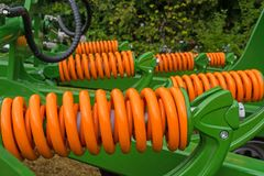Shock absorbers of the agricultural unit, which create impacts on the soil by working parts, in order to create cracks, to penetra royalty free stock photography