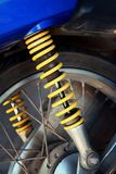 Shock absorbers of yellow motorcycles at the park Royalty Free Stock Photo