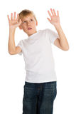 Shock and Awe. Young boy showing an expression of shock and awe, looking at something unpleasant or frightening Stock Image