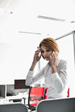 Shock businesswoman using cell phone in office Royalty Free Stock Photo