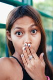 Shock face expressions concept. Closeup of shocked amazed woman covering mouth with hands.  Stock Image