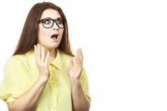 Shocked amazed woman gesturing with hands. Shock face expressions concept. Shocked amazed woman gesturing with hands seeing something surprising Royalty Free Stock Photos