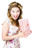 Shock horror pinup girl watching scary movie Stock Photos