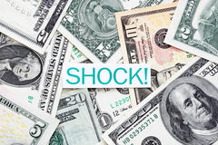 Shock label on US dollar bills. Background Royalty Free Stock Photography