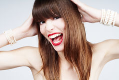Shock and laugh portrait of a young woman Royalty Free Stock Image