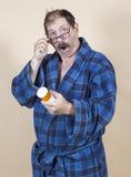 Shock of Medicine. Man shocked after reading medicine bottle Royalty Free Stock Image