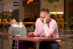 Shock from the offer on a marriage. Two in cafe - the girl in a faint from the offer Stock Photos