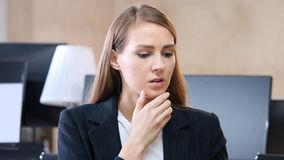 Woman Feeling Uncomfortable in Office Stock Image