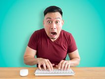 Shock and wow face of man on his work desk. Stock Photography
