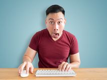 Shock and wow face of man on his work desk. stock photo
