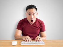 Shock and wow face of man on his work desk. royalty free stock photo