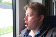 Shock. Young man shocked about something outside of his window Stock Images