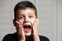 Shocked. A 9 year old boy with a surprised look on his face Royalty Free Stock Images