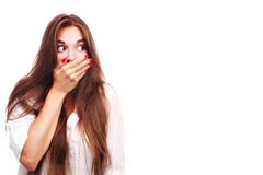 Shocked. Portrait of a surprised young woman with hands over her mouth Stock Photo