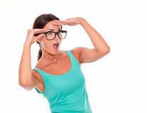Shocked adult woman with a hand to her forehead Royalty Free Stock Photo