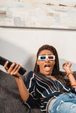 Shocked african american woman in 3d goggles looking. At camera stock photo