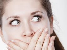 Shocked amazed woman covering mouth with hands Royalty Free Stock Photography