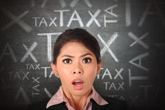 Shocked asian business woman with tax anoucement stock photography