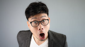 Shocked Asian businessman with glasses. stock images
