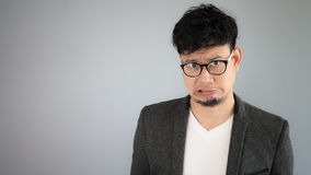 Shocked Asian businessman with glasses. Royalty Free Stock Photo