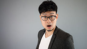 Shocked Asian businessman with glasses. stock photo