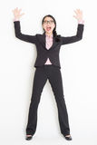 Shocked Asian businesswoman bang and leaning wall Stock Image
