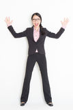 Shocked Asian businesswoman leaning wall Royalty Free Stock Photo