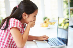 Shocked Asian Child Using Laptop At Home Stock Image