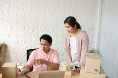 Shocked Asian couple business owner after look at clock. It`s ti royalty free stock photography