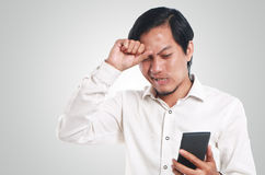 Shocked Asian Man With His Smart Phone Royalty Free Stock Photography