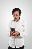 Shocked Asian Man With His Smart Phone royalty free stock photos