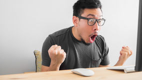 Shocked Asian man with his work. royalty free stock image