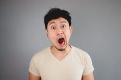 Shocked Asian man. Stock Photos