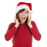 Shocked Asian Santa woman. Shouting isolated over white background. Asian female model Stock Images
