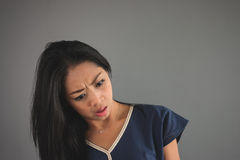 Shocked Asian woman in blue shirt. Royalty Free Stock Image