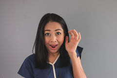 Shocked Asian woman in blue shirt. Stock Images