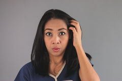 Shocked Asian woman in blue shirt. Stock Photo