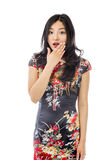 Shocked Asian woman with hand over mouth isolated on white background Royalty Free Stock Photography