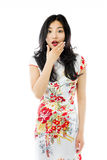 Shocked Asian woman with hand over mouth isolated on white background Stock Images