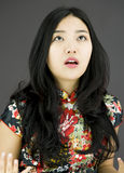 Shocked Asian woman with isolated on colored background Stock Photography