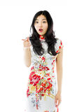 Shocked Asian young woman with pointing isolated on white background Stock Photo