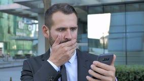 Shocked, Astonished Businessman Using Smartphone stock video