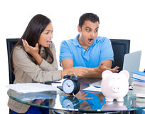 shocked attractive man and woman looking at bill on laptop Royalty Free Stock Images