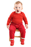 Shocked baby girl dressed in red isolated on white Royalty Free Stock Photography