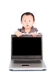 Shocked baby with a laptop Stock Images