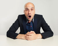 Shocked bald businessman stock photos