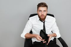 Shocked bearded man in white shirt showing empty wallet Stock Photography