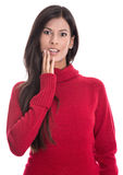Shocked beautiful brunette in long red jumper isolated on white Royalty Free Stock Photography