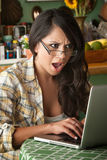 Shocked Beautiful Latina Woman with Computer Stock Image